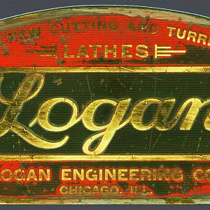 LoganBadge2 - Original early example of the Logan emblem. Background is the Benjamin Moore Baby Seal Grey color that is a very close math to the original.