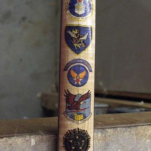 Cane made for my late Father. I embellished it with insignia's of his military record.