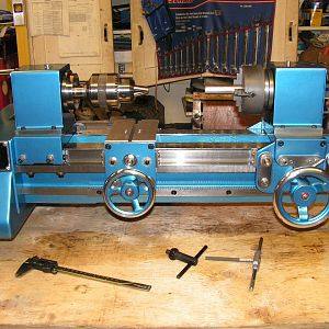 "1979 Heathway 11/4"" bore. 8"" swing glass blowing lathe. 17"" between spindles. Right hand spindle travels left and right as well as the ""fire carriage"""