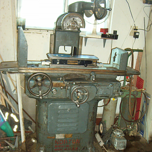 "This is a Norton 6 x 18 hydraulic surface grinder, or as it was called in its day, ""grinding machine"" It was built in 1942, the same year that it's designer,Charles H. Norton, died. I am in the process of fixing it up a bit, as it lacks some minor parts."