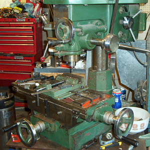"The Jet-16 Drilling & Milling Machine. 12 speeds, 9 3/8"" x 23 1/2"" table. It's missing the pulley covers, and therefore unfortunately the speed chart as well. But I got me a little 'lectronic tacho gaget, and one day I'll play me some ""musical fan belts"" and draw me up a chart."