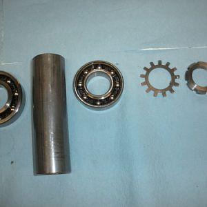 spindle assembly order starting at top of bearing set moving to the right (up the spindle)