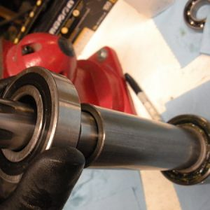 Install the top bearing. Install the side of the bearing that has the Thicker inner race towards the spacer.