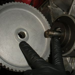 Install the timing gear pulley on to the pinion gear shaft.