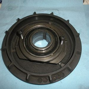 Brake bearing cap. This is just to show those two screws that hold the brake bearing cap to the lower belt housing.