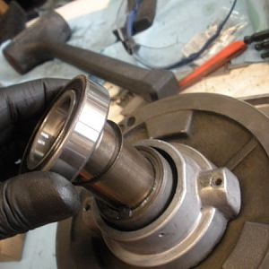 A new bearing (6007 double sealed) should be installed on top of the spindle pulley hub.