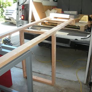 I placed a single support under the center. I made sure that the 2x4s were directly supporting the load.