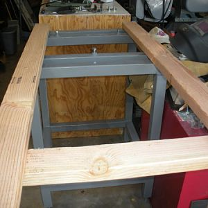 Another view of the rails on the stand. The mounting screws are turned down below the level of the sideways 2x4s
